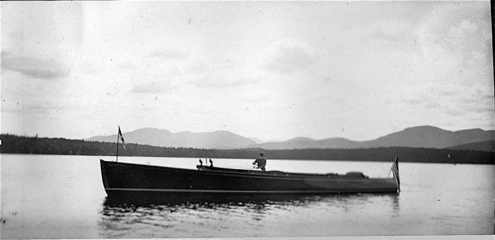 Henry Graves, Jr. piloting his50-foot motorboat the Eagle on Upper Saranac Lake, New York (Courtesy Stacy Perman, A Grand Complication)