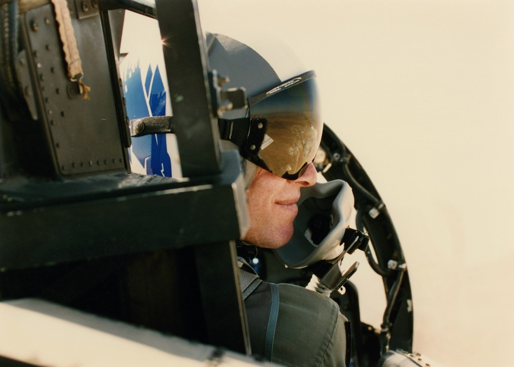 Torman piloting MiG with reflection of land on his visor