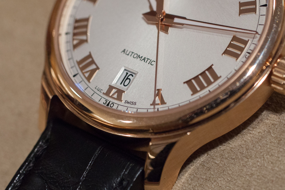 The clean dial, Chopard-style hands, and date window
