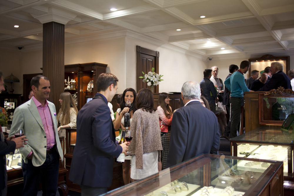 Guests Checking Out Watches And Sharing Stories