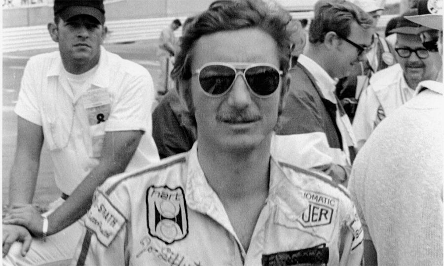 Jo Siffert seen with Heuer crest on his racing suit.