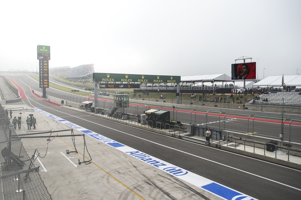 A foggy turn 1 in the distance.