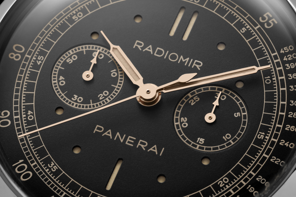 Luminous material visible through holes on the Oro Blanco's black dial