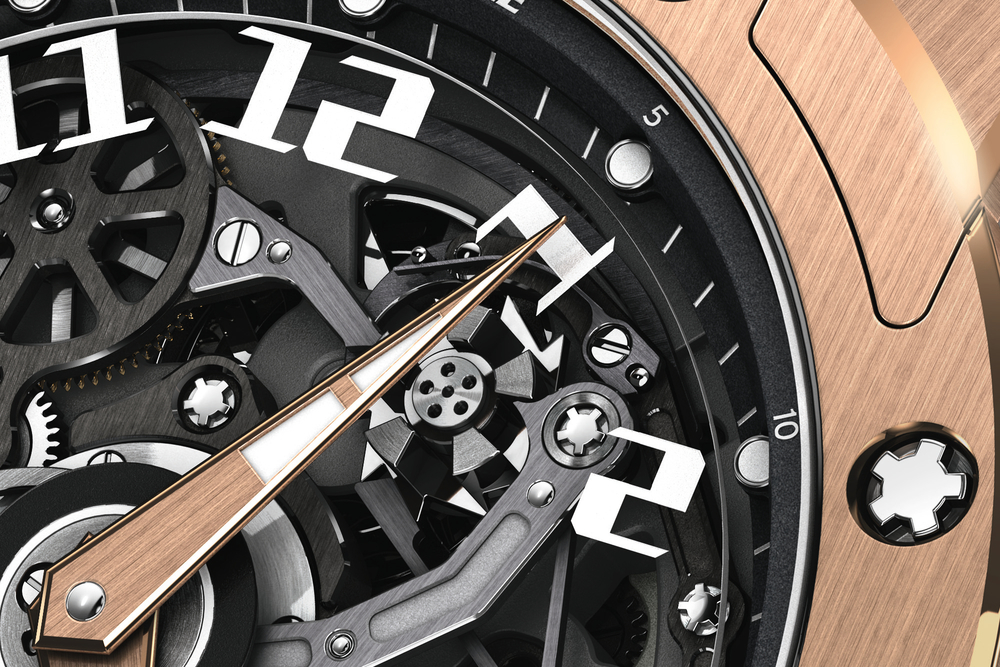 A column-wheel at 1 o'clock controls the rotation of a sapphire crystal disc with applied hours