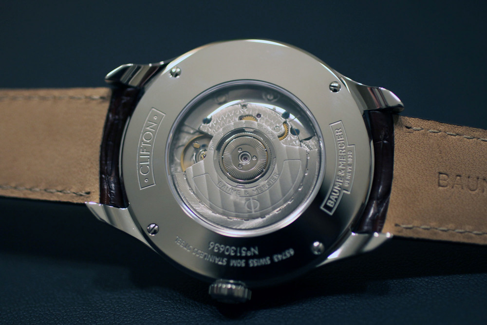 The Soprod 9094 movement is visible through a sapphire crystal case back
