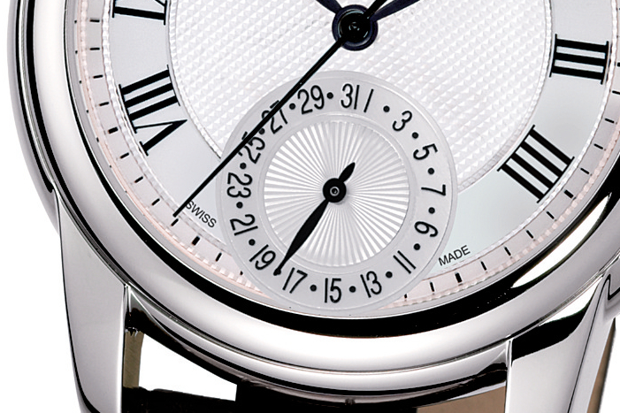 The date dial features sunray guilloché in contrast to the main dial's hobnail guilloché.