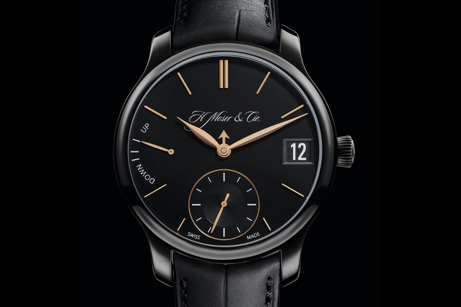 A short arrow-shaped hand indicates the months along 12 rose gold applied indices which do double duty as hour indicators.