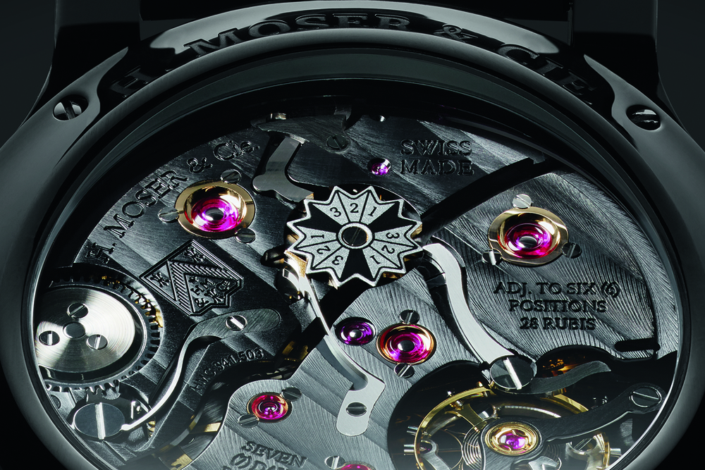 The black-and-white leap year indicator is immediately visible among hand-finished movement components.
