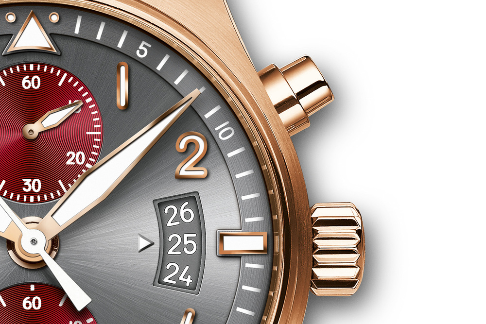 IWC's altimeter-style date display is visible through an aperture at 3 o'clock.