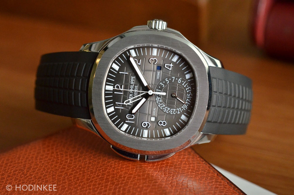 The 5990/1A features day/night indicators for both local and home time, just like the Aquanaut Travel Ref. 5164A.