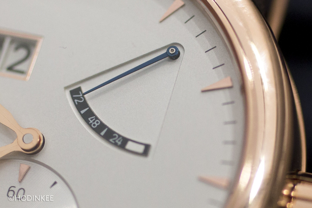 The use of gold extends to the dial, with hour indices, hands, and a frame around the date aperture.
