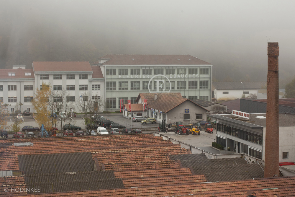 Fleurier Ebauches seen from Chopard Manufacture on a foggy day in Fleurier