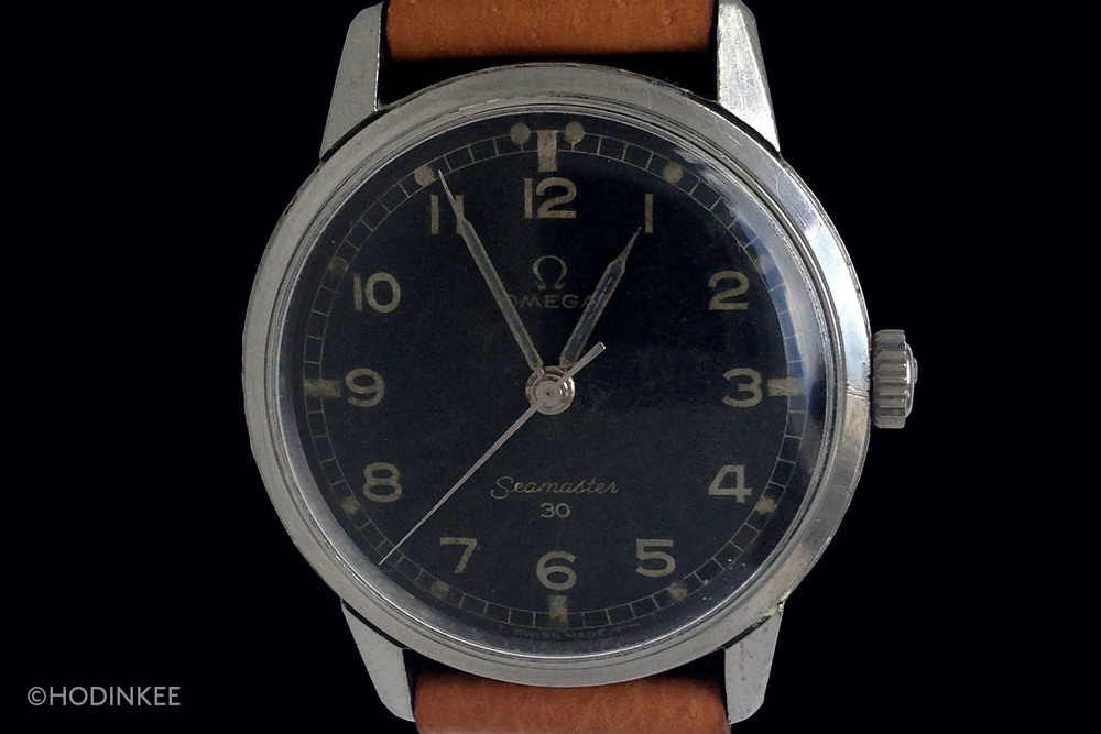 Omega Seamaster 30 watches with black dials generally command double the price of silver dial variants. This example, with MoD-style railroad minutes track is particularly uncommon.