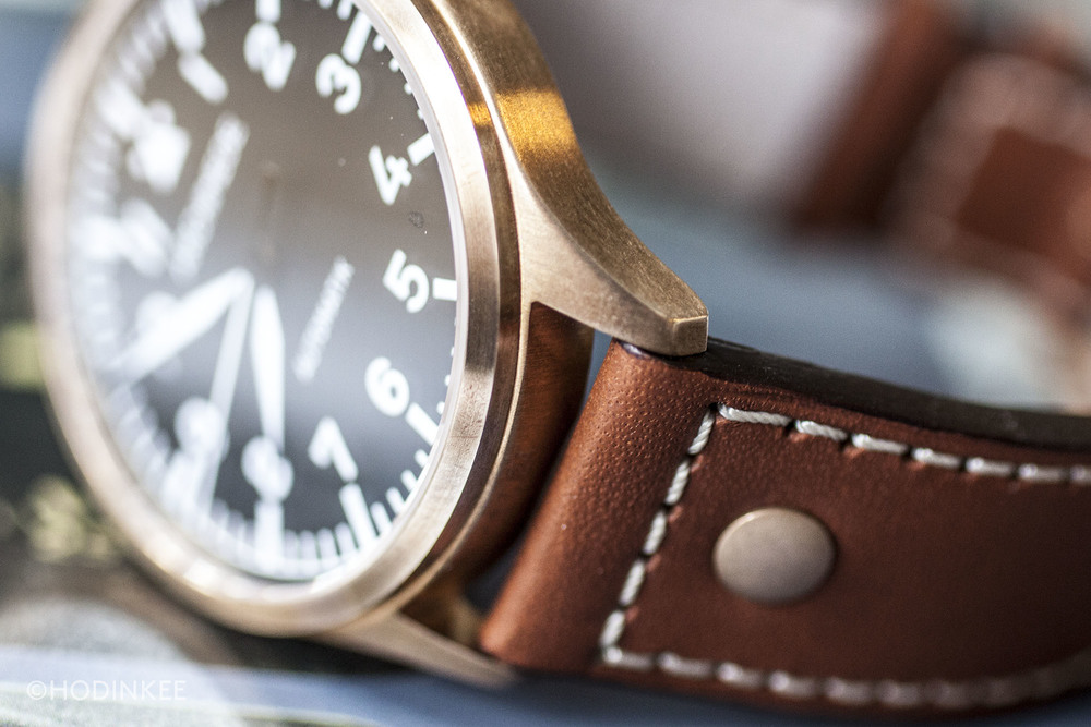 A uniformly brushed case finish adds to the casual wearability of this watch.