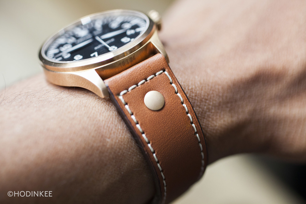 Brass rivets and contrast stitching create a more casual strap. A distressed leather strap could be another good option.