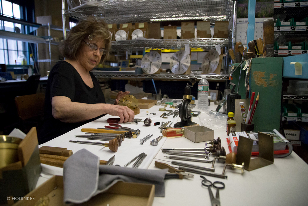Master clockmaker Jean Yeo working on a clock movement