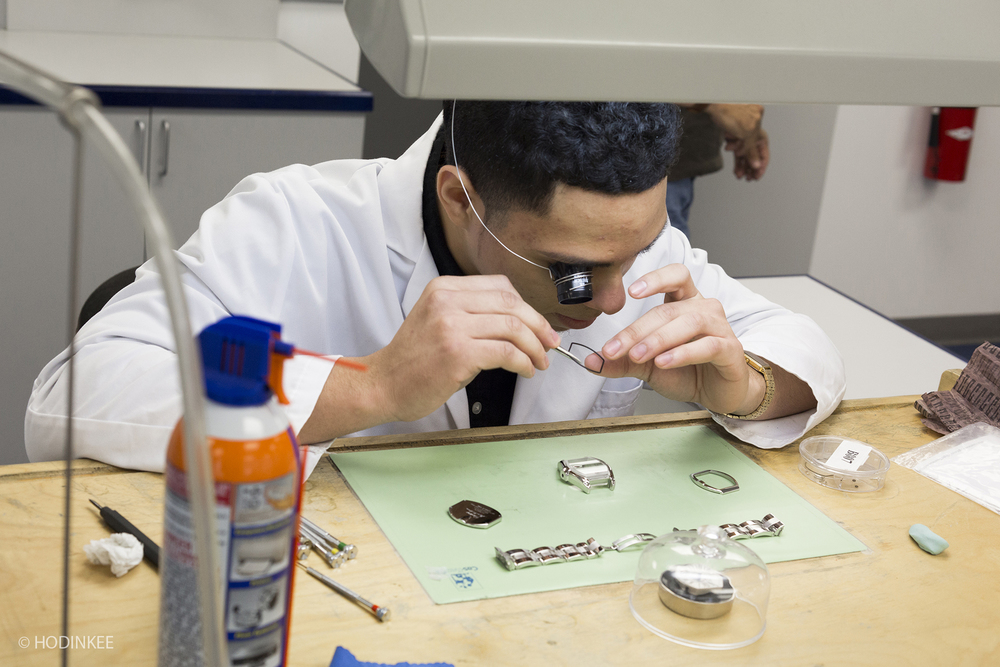 Edwin reassembles a Cartier Roadster sent in for servicing.