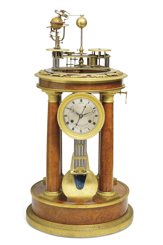 Raingo Frères - A Charles X Ormolu-Mounted Amboyna Striking Orrery Clock. Image courtesy Christies Inc.