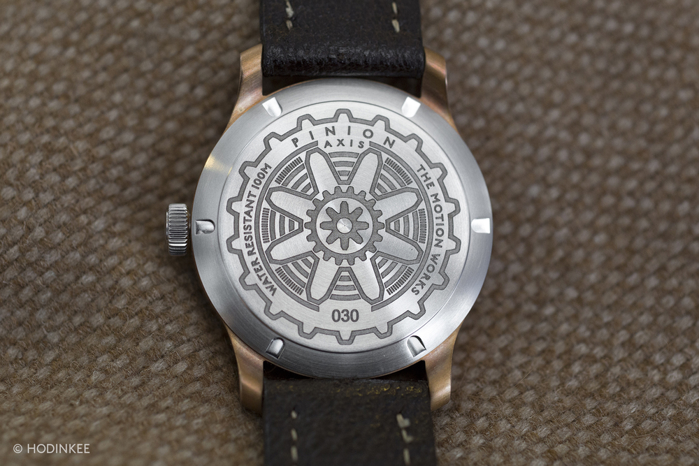 The solid stainless steel case back is laser-engraved with Pinion insignia.