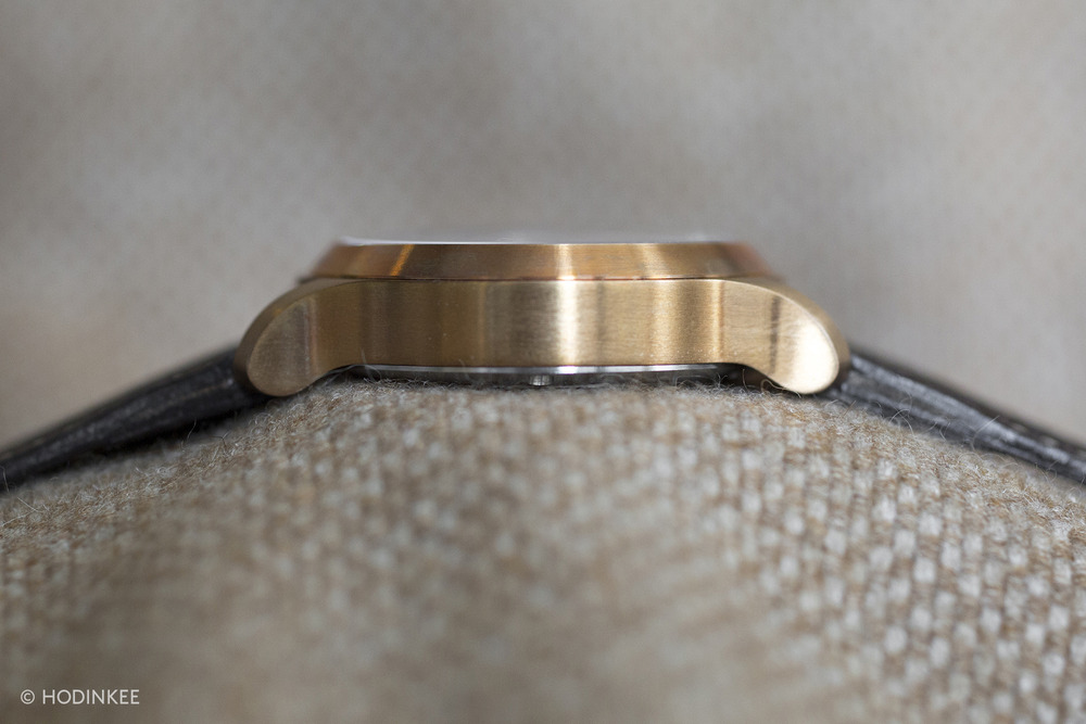 The solid bronze case is approximately 13mm thick.