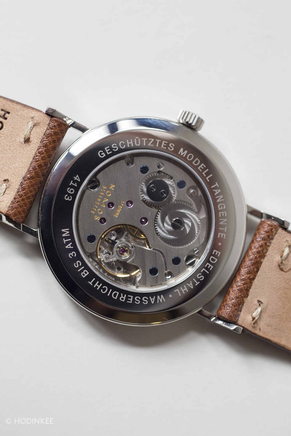 Nomos' caliber Alpha is based on a modified Peseux 7001. Nomos stopped using ebauches in 2005.