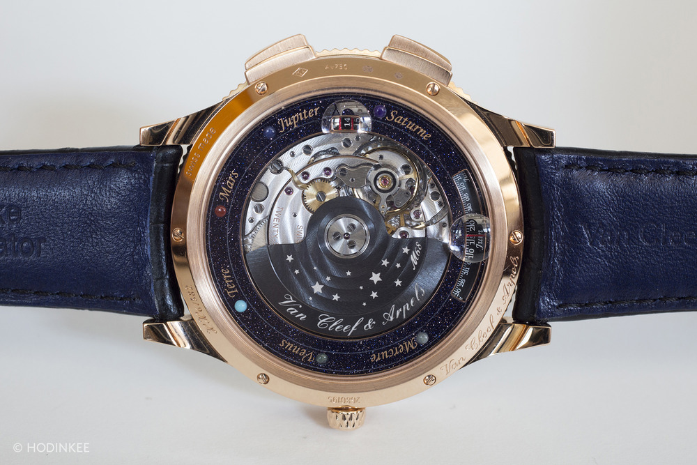 The Stern manufacture movement with custom Christiaan van der Klaauw module is visible through a sapphire crystal case back. Surrounding the crystal is a guide to all six planets and their representative gemstones.