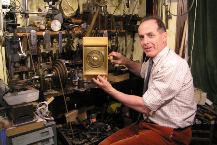Michael Wright displays his working model of the Antikythera Mechanism.