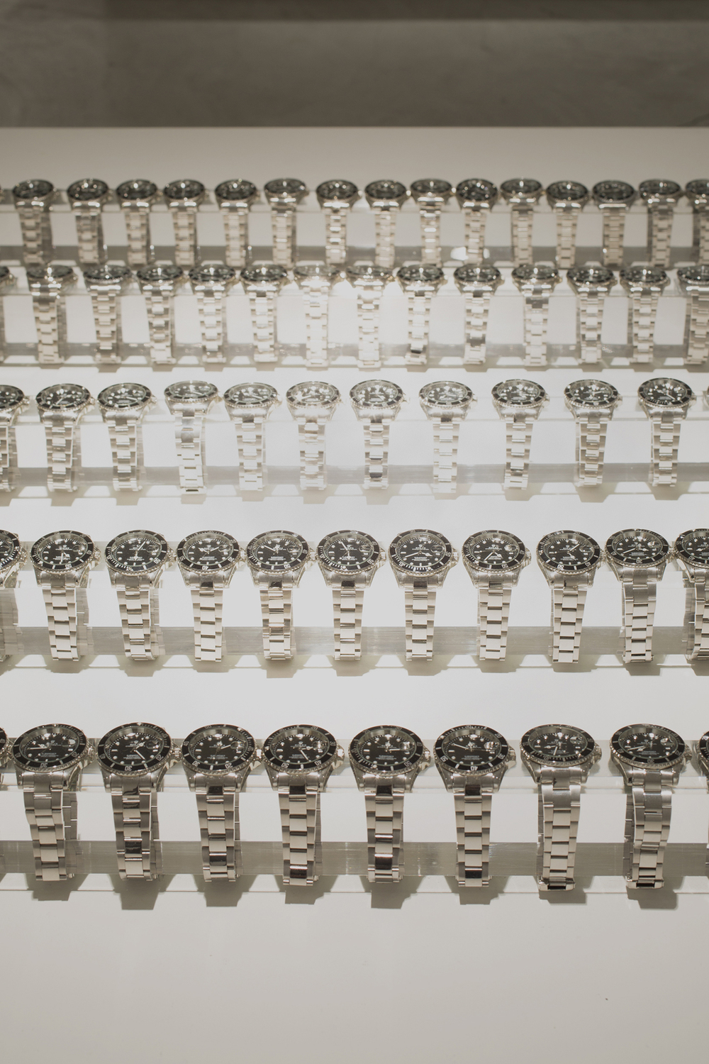 Among the 100 watches within this installation, only one is authentic.