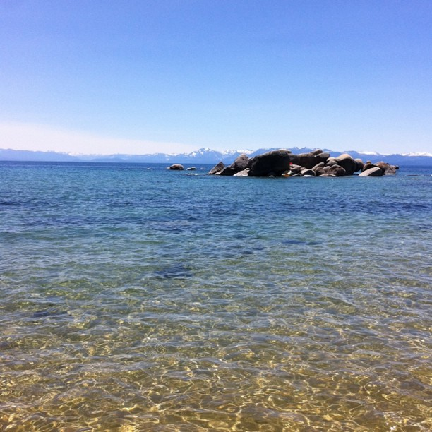 Crystal clear water and snow capped peaks in the background at South Lake Tahoe (Taken with instagram)