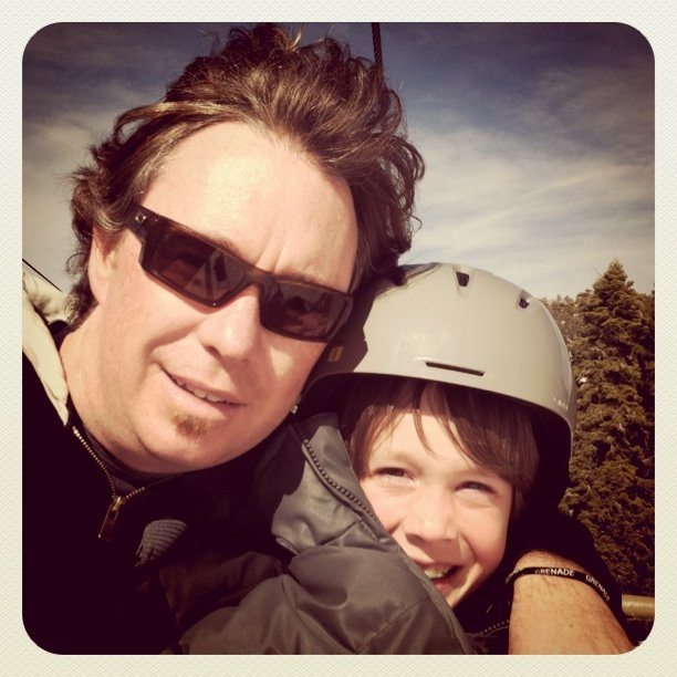 Me and my oldest on the lift or a day of boarding.  (Taken with  instagram )