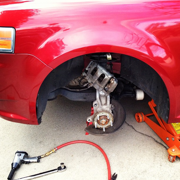 Just finished putting new brakes on my car. Pads and rotors. Pretty easy job. (Taken with instagram)