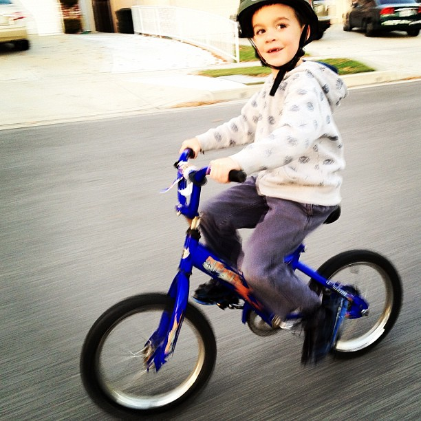 Jack speeding along. I took this today while spending some one-on-one time with him on an adventure of his choosing. I love that smile! (Taken with  instagram )