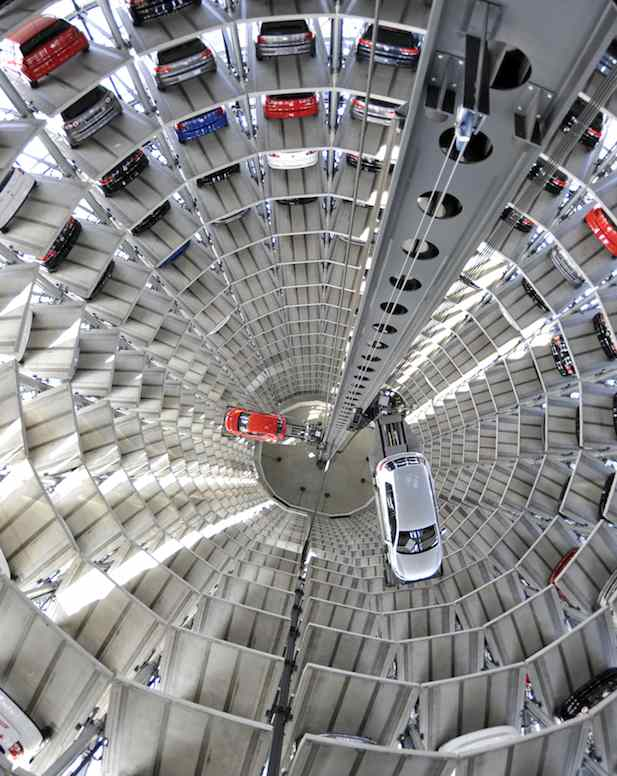 I want one. The garage, not the car.    peetypassion :      Photo You Must See: Vertical Volkswagens at Germany's Autostadt    Volkswagen Golfs are stacked in one of the massive glass silos at  Autostadt ,  the theme park adjacent to Volkswagen's main plant in Wolfsburg,  Germany.