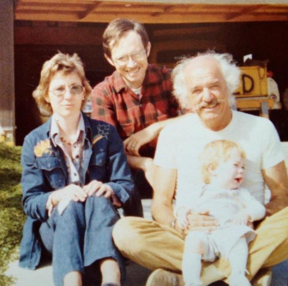 Granman with my parents, holding me