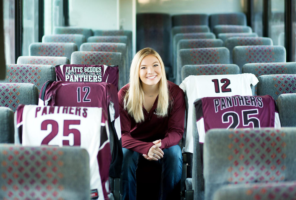 Sports Pictures on a Bus Senior Pictures by Katie Swatek Photography | South Dakota Senior Pictures by Katie Swatek Photography