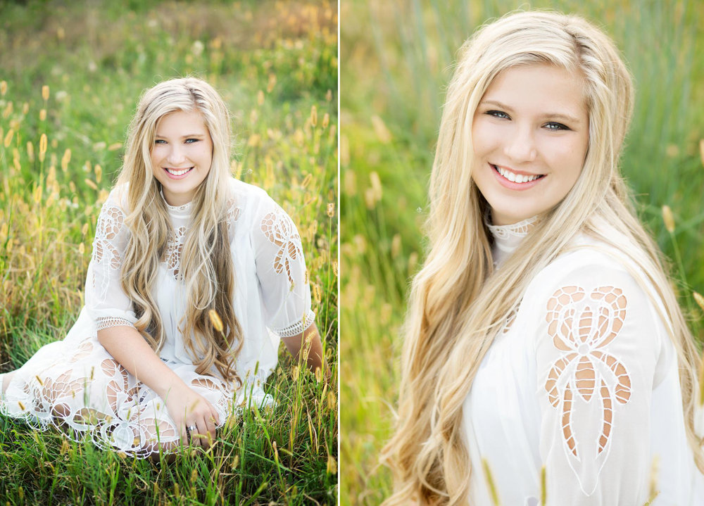 blonde senior girl in white flowy dress sitting in tall grass