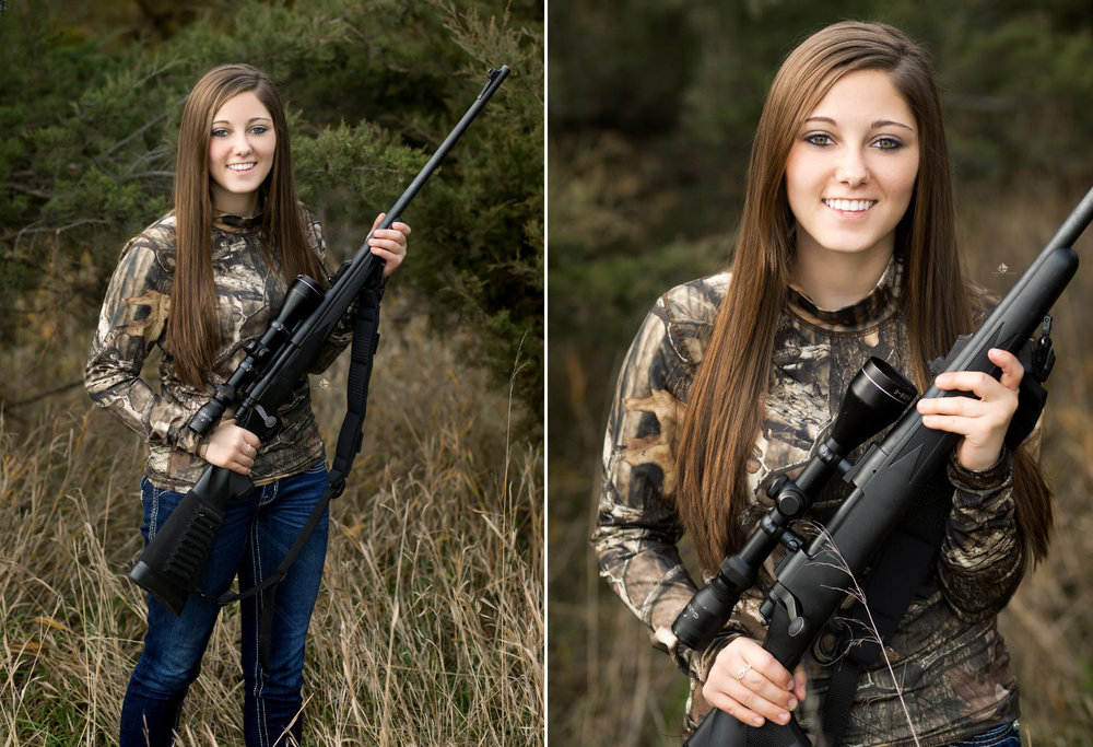 brunette senior girl in camouflage standing in the woods with a black rifle