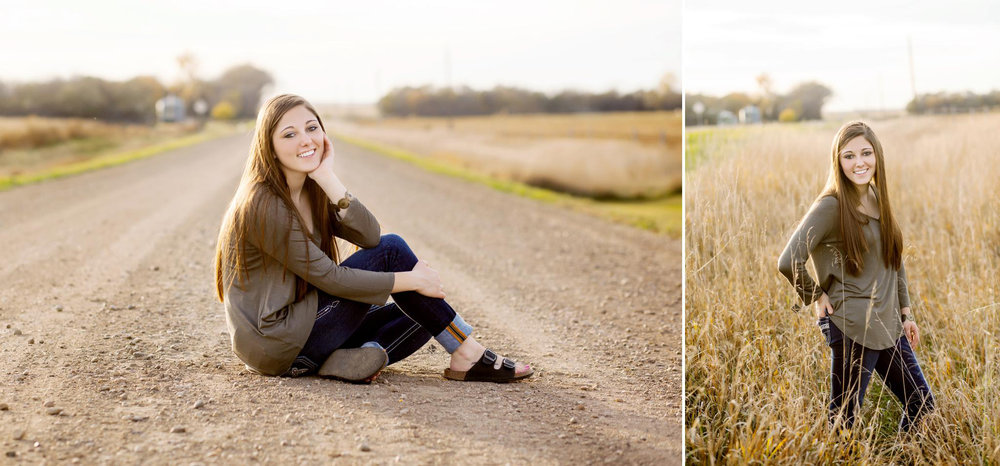 brunette senior girl in an olive top and dark jeans sitting on a gravel road and standing in tall grass in the fall