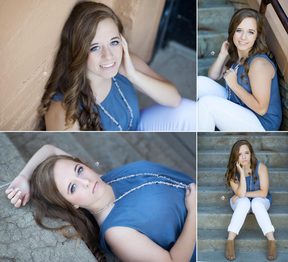 brunette senior girl in a blue top sitting and laying on cement stairs