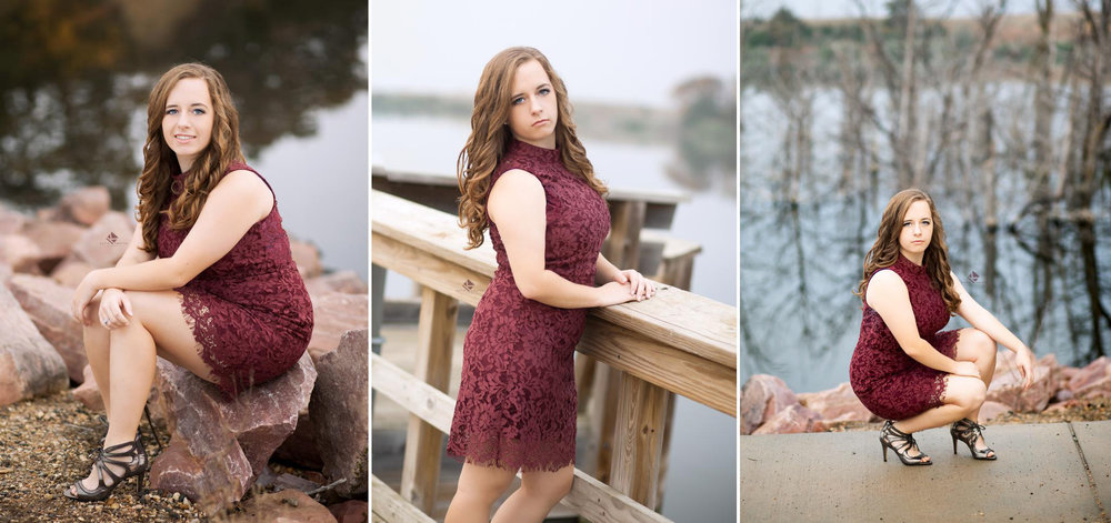 brunette senior girl in a wine colored, lace dress posing near water