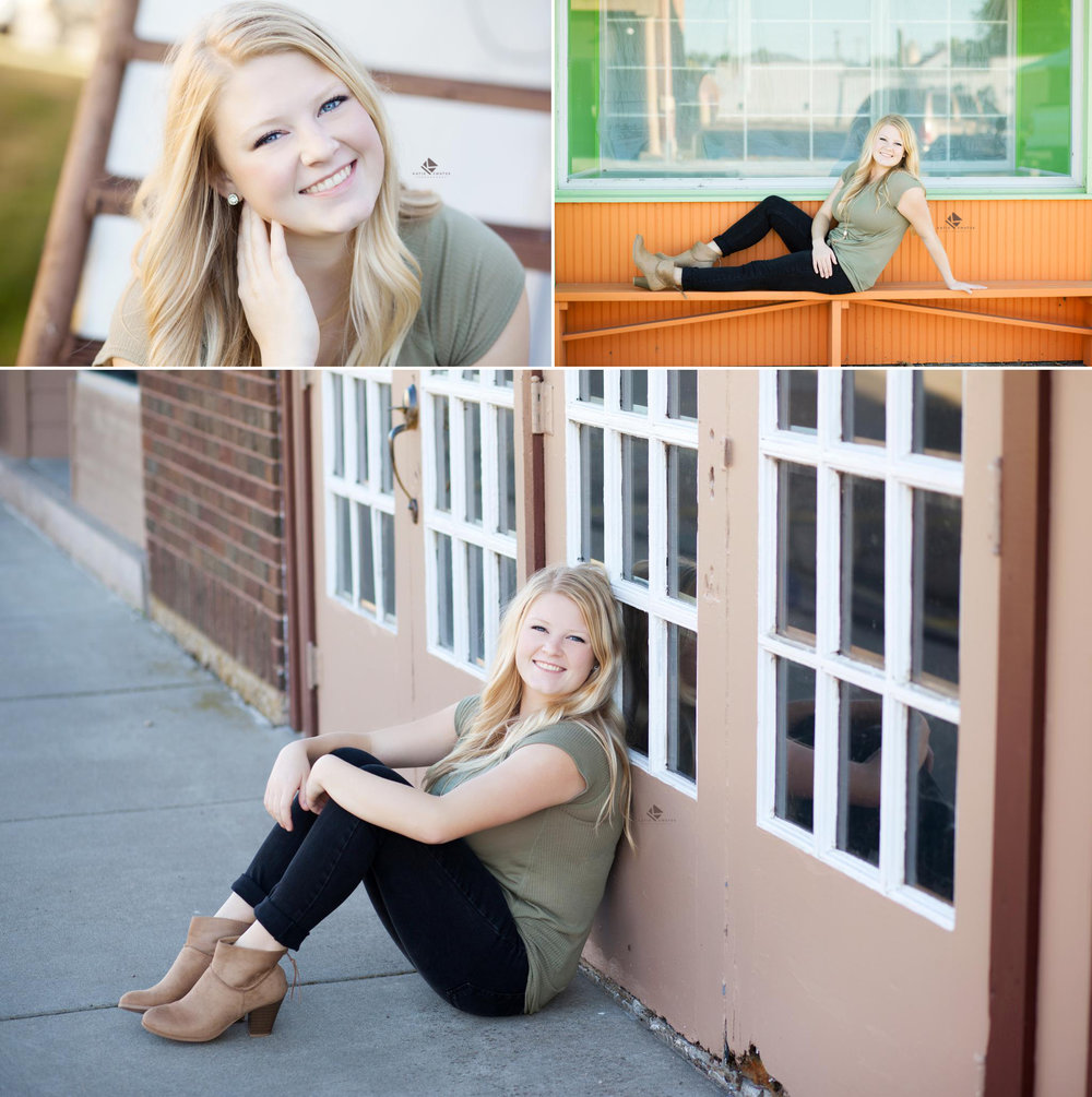 blonde senior girl in an olive top and black pants posing on Main Street in downtown Scotland, SD