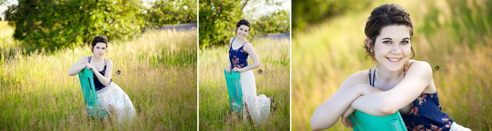 brunette senior girl in a blue floral shirt and a cream chiffon skirt posing in a tall grass field with a teal chair