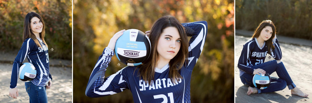 brunette senior girl in a west boyd high school volleyball jersey posing near fall foliage on a Nebraska sandbar