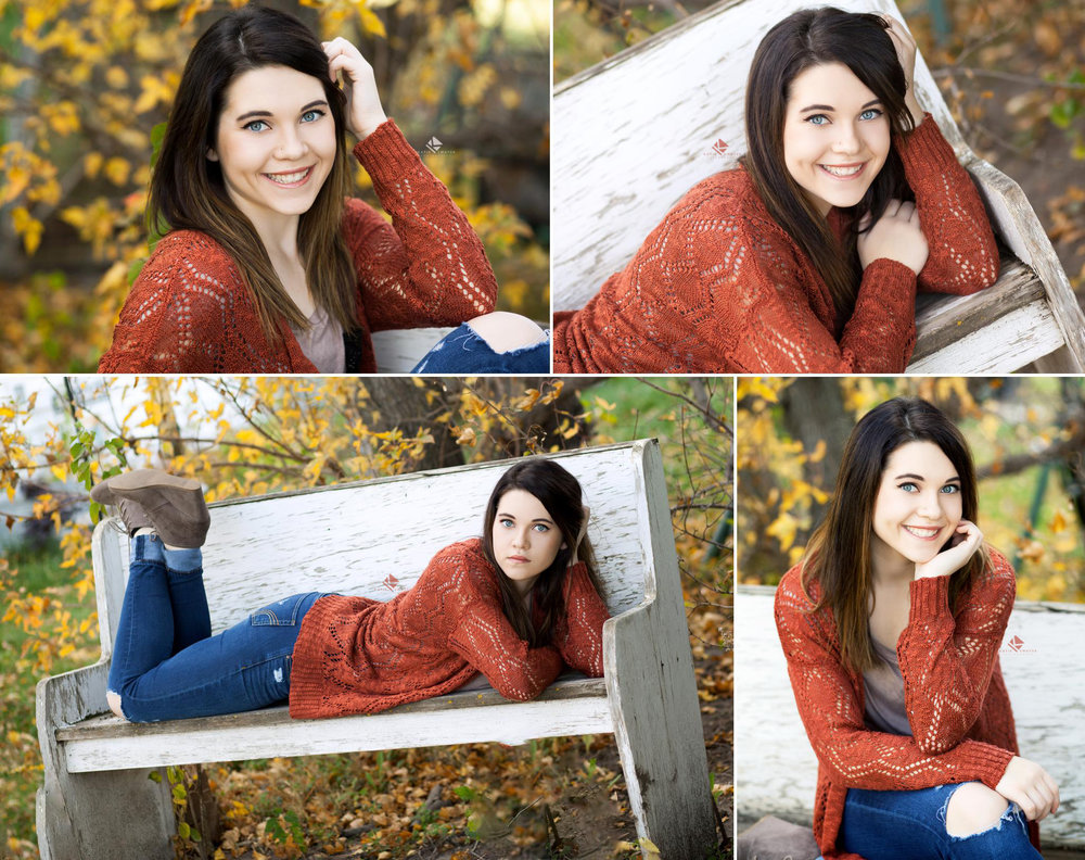 brunette senior girl in a burnt orange cardigan posing on a white wood bench