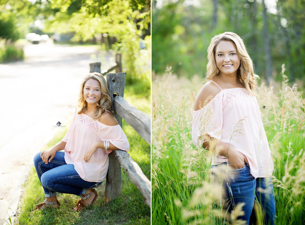 blonde senior girl in a blush colored, off the shoulder top standing next to a fence and in tall grass for senior pictures in Lake Andes South Dakota