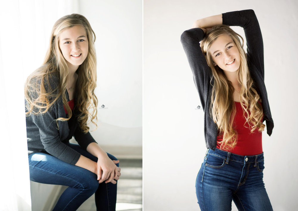 blonde senior girl in a gray cardigan with blue jeans posing in a white studio set up