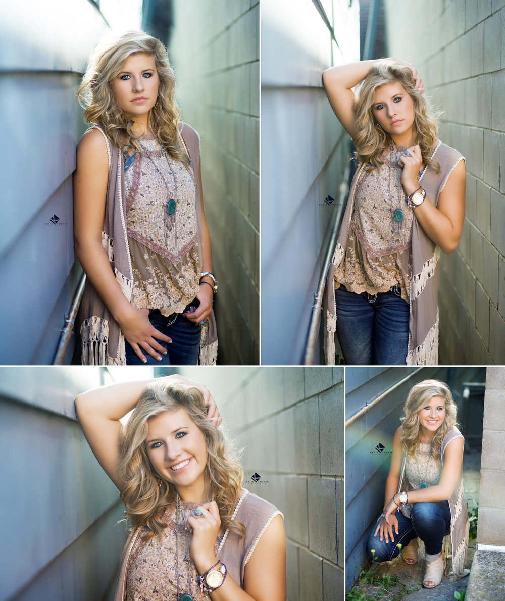 blonde senior girl in a tan top and jeans standing in between two buildings in an urban setting in Wagner SD