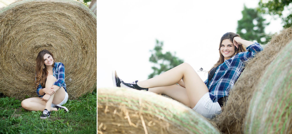 brunette senior girl in a black and blue plaid shirt and white shorts posing on and by a hay bale