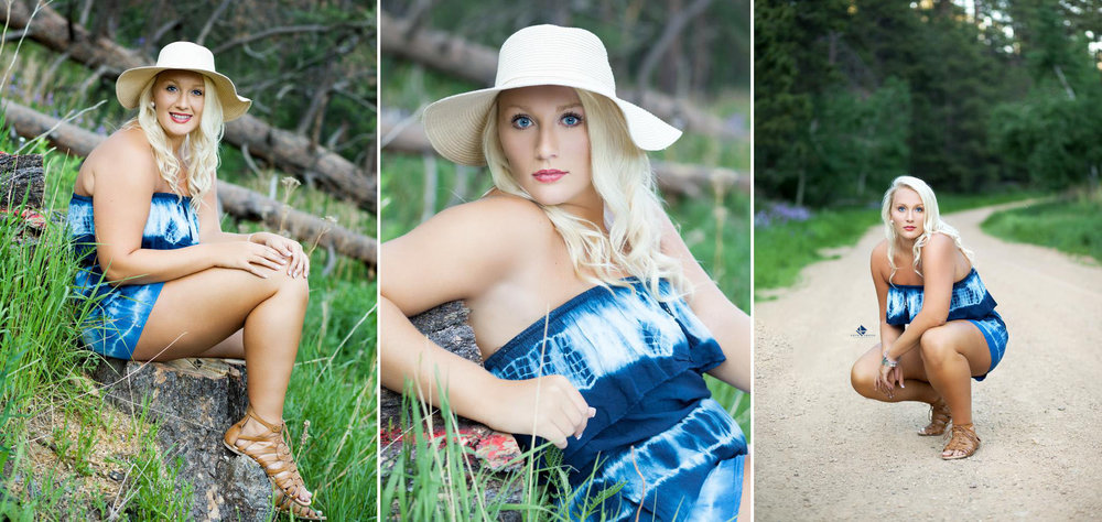 blonde senior girl in a blue and white tie-dye romper sitting in trees in the Black Hills national forest