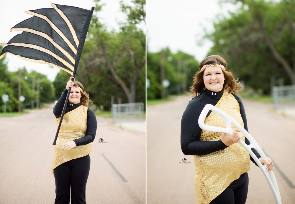 brunette senior girl in a gold flag throwing costume